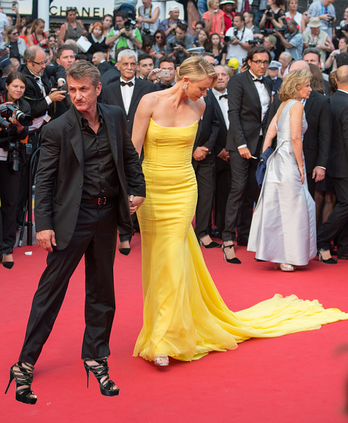"""CANNES, FRANCE - MAY 14:  Sean Penn and Charlize Theron attend the """"Mad Max : Fury Road""""  Premiere during the 68th annual Cannes Film Festival on May 14, 2015 in Cannes, France.  (Photo by Samir Hussein/WireImage)"""
